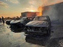 آتشسوزی مرگبار در محل نگهداری سیلندرهای گاز مایع/ سرایت آتش به ۶ خودرو